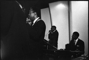 Thumbnail of Muddy Waters Blues Band at the Boston Tea Party: Sammy Lawhorn, Luther 'Georgia Boy' Johnson, Birmingham Jones playing harmonica, and S. P. Leary on drums, from left to right