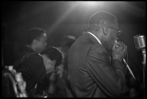 Thumbnail of Muddy Waters Blues Band at the Boston Tea Party: Birmingham Jones playing harmonica with Luther 'Georgia Boy' Johnson and Sammy Lawhorn in the background