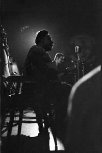 Thumbnail of Muddy Waters Blues Band at the Boston Tea Party: Muddy Waters seated with an acoustic guitar