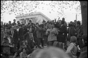 Thumbnail of Vote With your Feet anti-Vietnam War protest march man speaking among crowd of protestors
