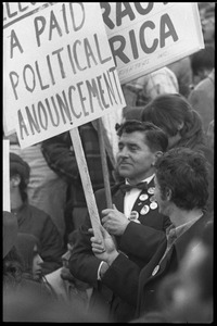 Thumbnail of Vote With your Feet anti-Vietnam War protest march protestor holding sign in front of a counter-protestor