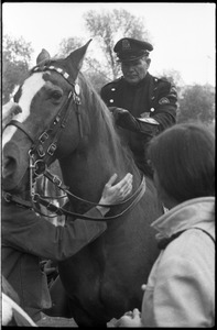 Thumbnail of Vote With your Feet anti-Vietnam War protest march protestors petting police horse