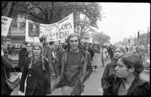 Thumbnail of Vote With your Feet anti-Vietnam War protest march Long line of protesters marching through the streets, Marcia Braun (front             right), with banner reading 'Bring the troops home now'