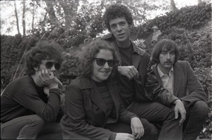 Thumbnail of Members of the Velvet Underground posing in a garden in Cambridge