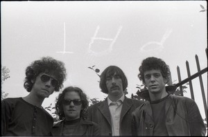 Thumbnail of Members of the Velvet Underground posing in a garden in Cambridge: sky-written 'PAT' above heads