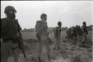 Thumbnail of Antiwar demonstration at Fort Dix, N.J.:  line of military police in gasmasks         and riot gear