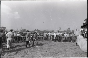 Thumbnail of Antiwar demonstration at Fort Dix, N.J.: line of protesters holding pipe,             advancing