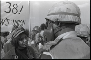 Thumbnail of Antiwar demonstration at Fort Dix, N.J.: protester speaking with military             policeman in gas mask