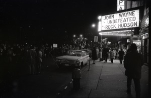 Thumbnail of Young Americans for Freedom pro-Vietnam War demonstration, Boston Common: Crowd             in front of movie theater showing John Wayne's Undefeated