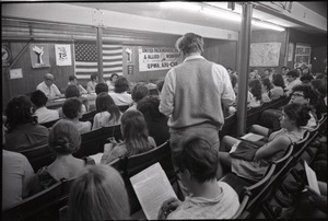 Thumbnail of Student Mobilization Committee to End the War in Vietnam meeting against SDS             violence: view over audience of speakers