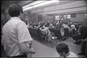 Thumbnail of Student Mobilization Committee to End the War in Vietnam meeting against SDS             violence: view of audience and speakers