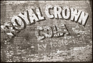 Thumbnail of Roxbury rambling: worn Royal Crown cola advertisement on brick wall