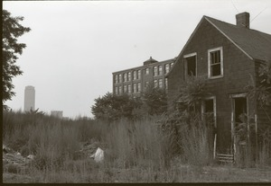 Thumbnail of Roxbury rambling: overgrown lot in front of abandoned house, Prudential Center             in background