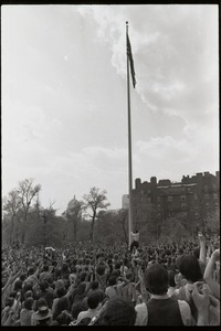 Thumbnail of Demonstration at State House against the killings at Kent State: protesters             surrounding and attempting to lower the American flag