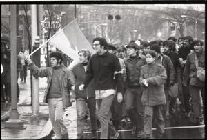 Thumbnail of MIT I-Lab demonstration: protesters in front of Building 10, one waving North             Vietnamese flag