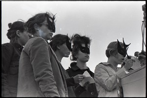 Thumbnail of Anti-war rally at Soldier's Field, Harvard University: members of feminist group Bread and Roses speaking while wearing masks