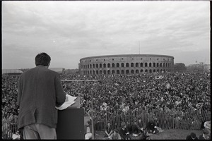 Thumbnail of Anti-war rally at Soldier's Field, Harvard University: Howard Zinn speaking to crowd with Harvard Stadium in the background