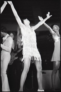 Thumbnail of Ike and Tina Turner Revue at the Boston Arena: Tina Turner performing with Ike Turner and a member of the Ikettes in the background