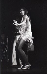 Thumbnail of Ike and Tina Turner Revue at the Boston Arena: Tina Turner performing with Ike Turner in the background