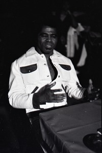 Thumbnail of James Brown at the Sugar Shack: Brown seated at a table