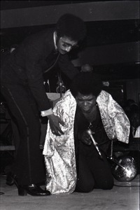 Thumbnail of James Brown at the Sugar Shack: Danny Ray putting cape on Brown