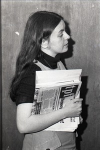Thumbnail of Bernadette Devlin McAliskey at the WBCN studios, holding copy of 'the people first'