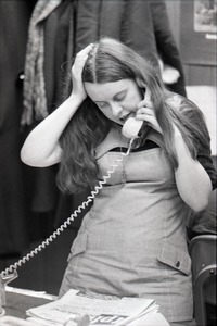 Thumbnail of Bernadette Devlin McAliskey on the phone at the WBCN office