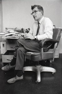 Thumbnail of Noam Chomsky in his office at MIT