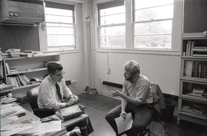 Thumbnail of Noam Chomsky with an interviewer in his office at MIT