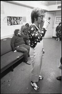 Thumbnail of Elton John backstage and performing at the Boston Tea Party: Elton John drinking beer with John Hochheimer in background