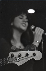 Thumbnail of Linda Ronstadt at Paul's Mall: Fender Precision bass headstock in foreground