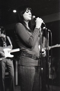 Thumbnail of Linda Ronstadt at Paul's Mall: Ronstadt performing with Gib Guilbeau on fiddle and John Beland on guitar