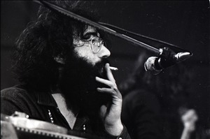 Thumbnail of New Riders of the Purple Sage opening for the Grateful Dead at Sargent Gym, Boston University: Jerry Garcia smoking a joint