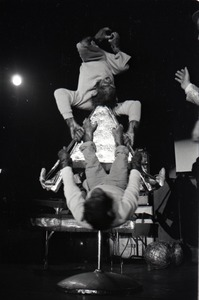 Thumbnail of Chimpanzee vaudeville act opening for the Grateful Dead at Sargent Gym, Boston University: chimpanzees balancing upside-down