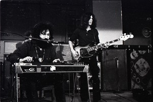 Thumbnail of New Riders of the Purple Sage opening for the Grateful Dead at Sargent Gym, Boston University: Jerry Garcia playing a pedal steel guitar, Dave Torbert on right