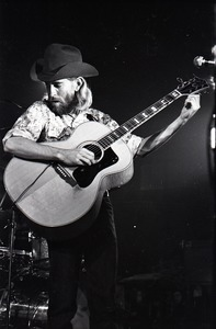 Thumbnail of New Riders of the Purple Sage opening for the Grateful Dead at Sargent Gym, Boston University: John 'Marmaduke' Dawson tuning acoustic guitar