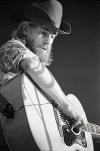 Thumbnail of New Riders of the Purple Sage opening for the Grateful Dead at Sargent Gym, Boston University: John 'Marmaduke' Dawson playing acoustic guitar