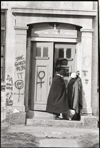Thumbnail of Women's occupation of the Architectural Technology Workshop, Harvard University:         two women in blankets, dog, huddled in doorway to ATW