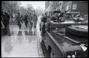 Thumbnail of Vietnam Veterans Against the War demonstration 'Search and destroy': veterans             riding in jeep along Tremont Street