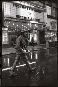 Thumbnail of Vietnam Veterans Against the War demonstration 'Search and destroy': veteran (W.         B. Mabrin?) marching past State Theater, Combat Zone