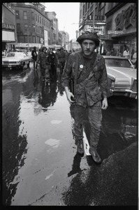Thumbnail of Vietnam Veterans Against the War demonstration 'Search and destroy': veteran (W.         B. Mabrin?) marching on the street, Combat Zone