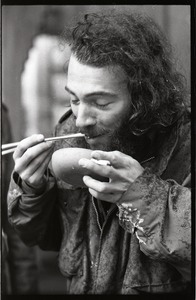 Thumbnail of Vietnam Veterans Against the War demonstration 'Search and destroy': veteran             eating from a bowl with chopsticks