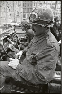 Thumbnail of Vietnam Veterans Against the War demonstration 'Search and destroy': veterans             driving in jeep down Washington Street