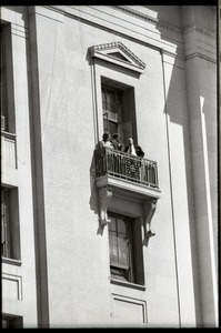 Thumbnail of May Day demonstrations and street actions by the Justice Department: people on             balcony of Justice Department building, observing