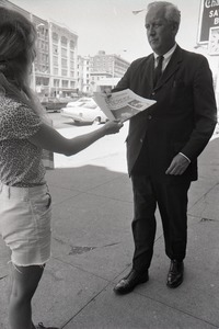 Thumbnail of Boston Phoenix promotional photos: Phoenix hawker handing paper to man