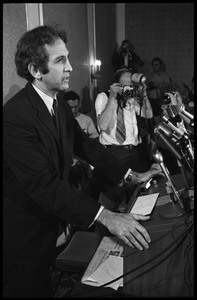 Thumbnail of Daniel Ellsberg at the podium, speaking at a press conference following the       Supreme Court decision to allow publication of the Pentagon Papers View from the side with press photographers in the background