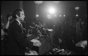 Thumbnail of Daniel Ellsberg at the podium, speaking at a press conference following the       Supreme Court decision to allow publication of the Pentagon Papers View over Ellsberg's shoulder, with the press in the background