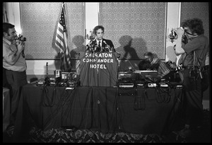 Thumbnail of Daniel Ellsberg at the podium, speaking at a press conference following the       Supreme Court decision to allow publication of the Pentagon Papers View from the audience with press on either side