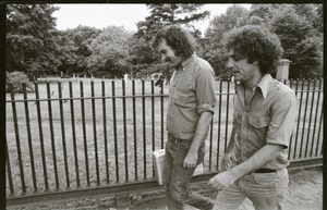 Thumbnail of Abbie Hoffman and George Kimball walking past a cemetery (Garden Street side of Old Burying Ground)