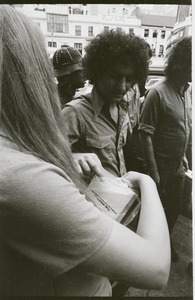 Thumbnail of Abbie Hoffman walking in Harvard Square, talking with young woman (Church of the Final         Judgment)